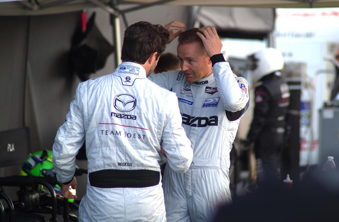 Mazda #55 codrivers in conversation.
