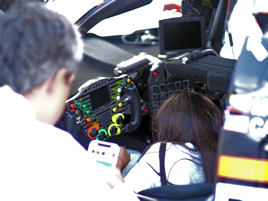 #6 Penske Acura driver Juan Montoya showing his office to one of