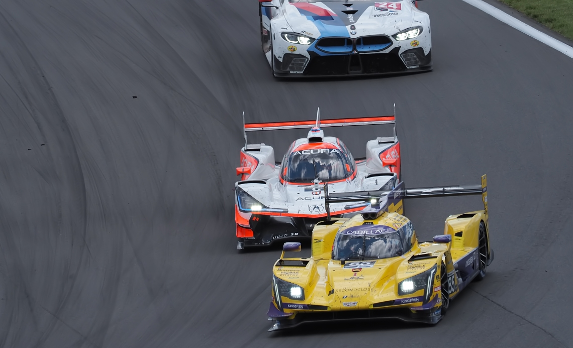 Penske Acura #6 is in  third place at Turn #1.