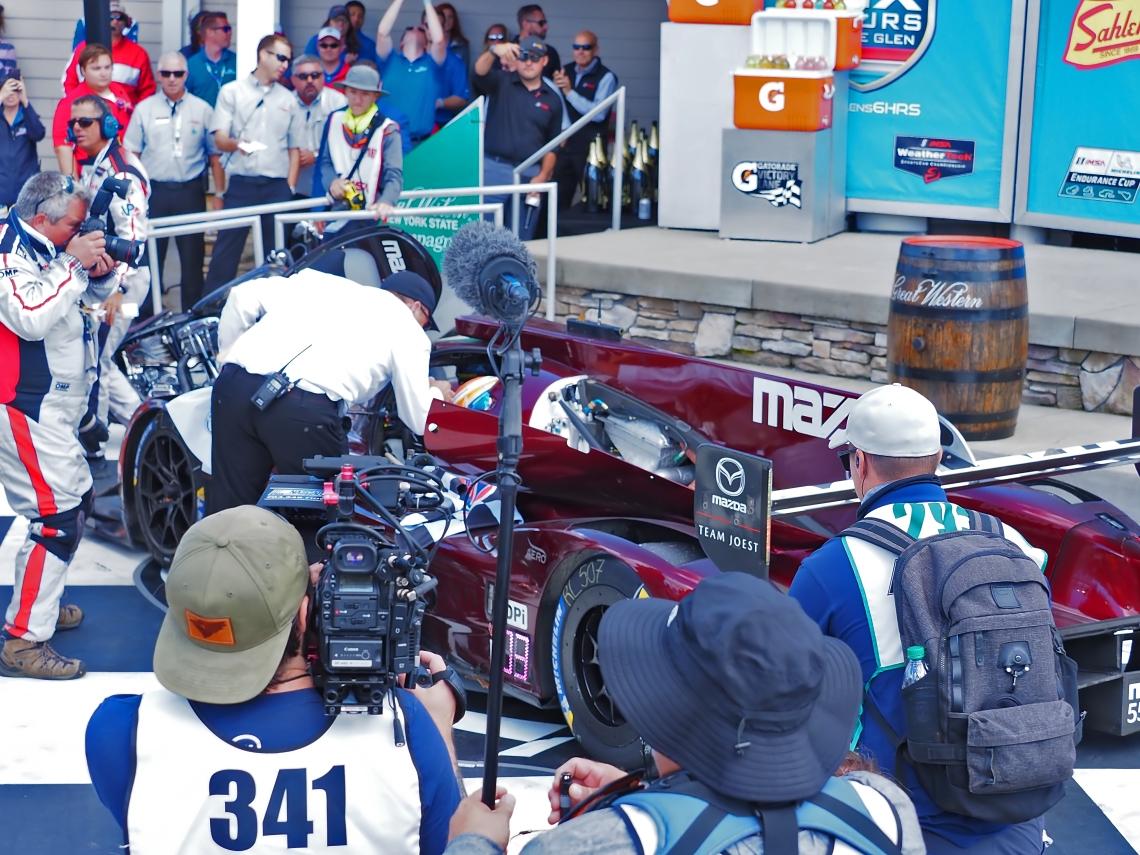 Mazda #55 at the victory podium.